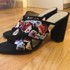 Black heeled sandals with floral straps